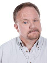 photo-24768393-old-man-raising-his-eye-brow