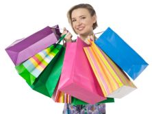 photo-24821962-a-happy-woman-with-shopping-bags