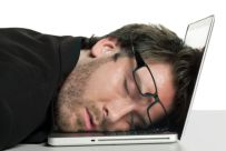 photo-24774997-businessman-sleeping-on-his-laptop