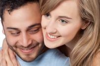photo-24769665-a-young-couple-smiling