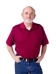 photo-24769120-old-man-standing-and-looking-at-the-camera