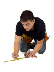 photo-24787605-young-carpenter-with-measuring-tape