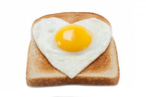 photo-24734018-bread-toast-with-a-fried-egg-in-a-heart-shape.