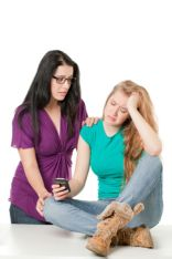 photo-24790059-sad-woman-holding-cellphone-with-her-friend