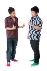 photo-24765824-two-young-men-having-a-conversation