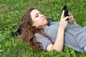 photo-24745211-woman-and-cell-phone (1)