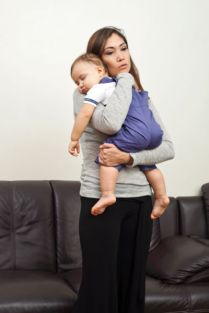 photo-24765218-mid-age-woman-carrying-a-sleeping-baby