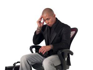 photo-24723911-tensed-businessman-sitting-on-chair.