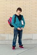 photo-24718877-handsome-teenage-boy-holding-books.