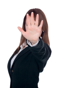 Caucasian businesswoman putting her hand on front to say stop
