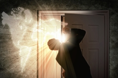 Image of young businessman opening door with lights