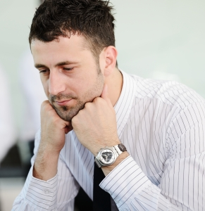 Tired businessman working in office