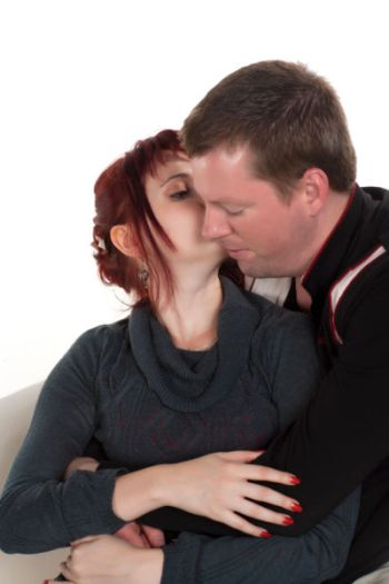 photo-24779825-woman-kissing-her-man-on-cheek